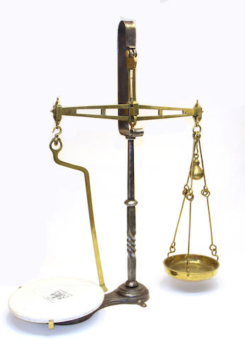 An English iron, brass and ceramic store scale