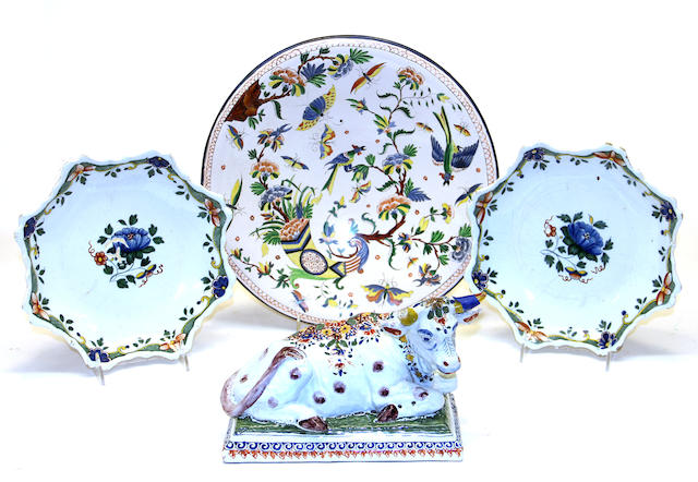 Three French faience dishes and a Dutch Delft cow 18th/19th century