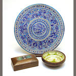 A Continental stoneware charger, French faience and pigskin bowl and a walnut cigarette box with silver and enamel plaque second quarter 20th century