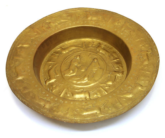 A Continental repoussé brass alms dish, oval engraved nickel platter and a brass lion mask. 19th/20th century