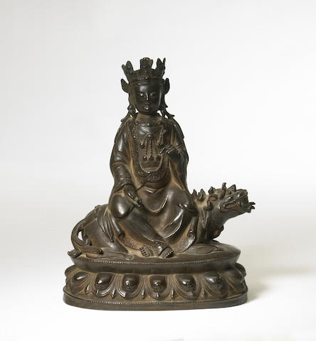 A cast bronze figure of Manjusi on a lion China, 20th century