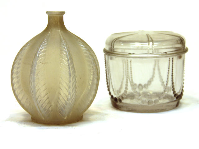 A René Lalique partial frosted and stained opalescent glass vase in the Malines pattern and a glass dresser box in the Perles pattern