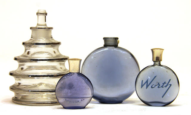 Three René Lalique for Worth glass perfume bottles and another
