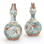 A pair of Imari style polychrome enameled porcelain double gourd vases Meiji period
