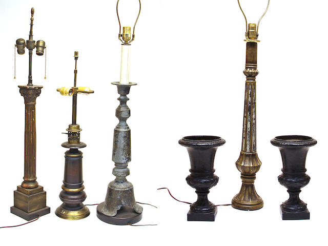 Four various table lamps and a pair of cast iron urns