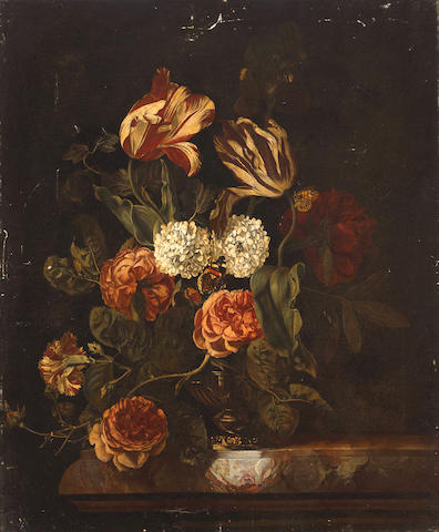 Circle of Rachel Ruysch (Amsterdam 1664-1750) A still life with tulips, roses and other flowers in a vase resting on a ledge 25 x 20 3/4in (63.5 x 52.7cm)