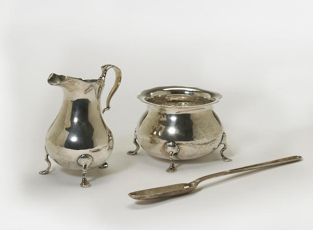 A Regency silver cream pitcher and sugar bowl set in the George II taste by Craddock & Reid, London, 1815  With armorial  (3)