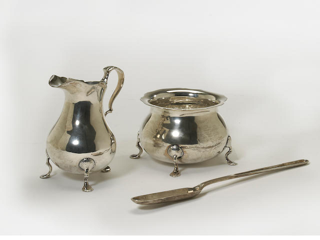 A Regency silver cream pitcher and sugar bowl set in the George II taste by Craddock & Reid, London, 1815 <BR />With armorial  (3)