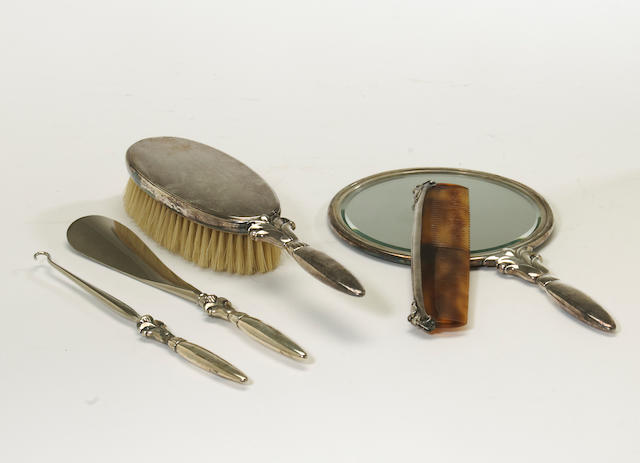 A Danish sterling mounted five piece vanity set by Georg Jensen, Copenhagen, post 1945 <BR /># 172, designed by Harald Neilsen  (5)