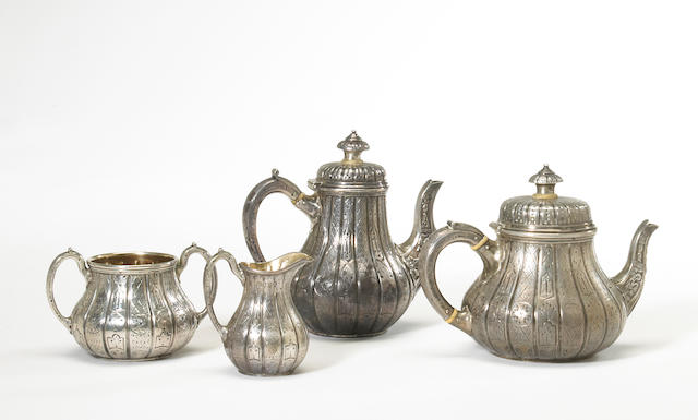 A Victorian silver four piece bachelor's tea and coffee set with chased panel decoration by Hunt & Roskell, London, 1864/1869  #s 5300 (tea set), 3110 (coffee pot), monogrammed, and later engraved on undersides: C. H. McL  (4)
