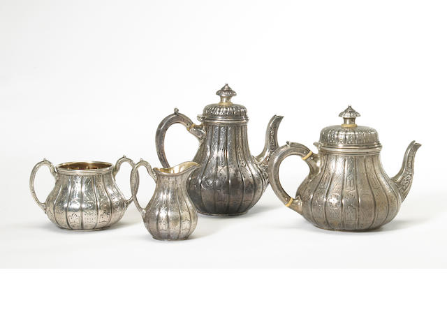A Victorian silver four piece bachelor's tea and coffee set with chased panel decoration by Hunt & Roskell, London, 1864/1869 <BR />#s 5300 (tea set), 3110 (coffee pot), monogrammed, and later engraved on undersides: C. H. McL  (4)