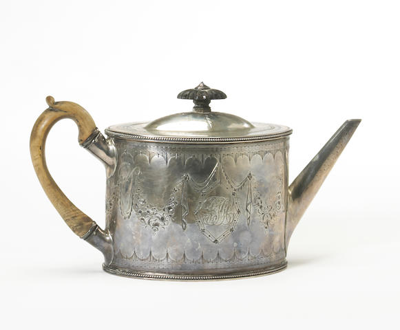 A George III silver beaded oval teapot with bright cut decoration and wooden fittings by Thomas Daniel, London, 1786, stamped: Silver*Lion, Foster Lane With original and later monograms