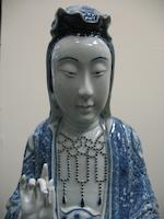 A tall blue and white porcelain figure of Guanyin  20th century