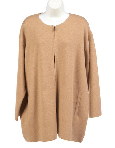 A camel zip front cashmere sweater