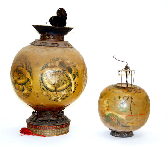 A group of five pig skin lanterns with painted decoration