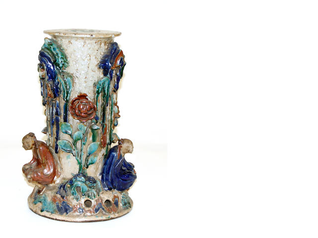 A glazed earthenware pedestal