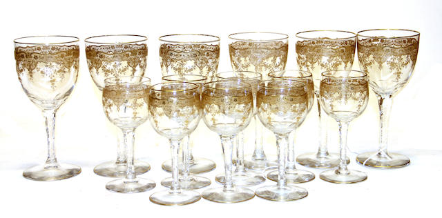 Six French gilt cut glass goblets and eight matching white wine glasses first quarter 20th century