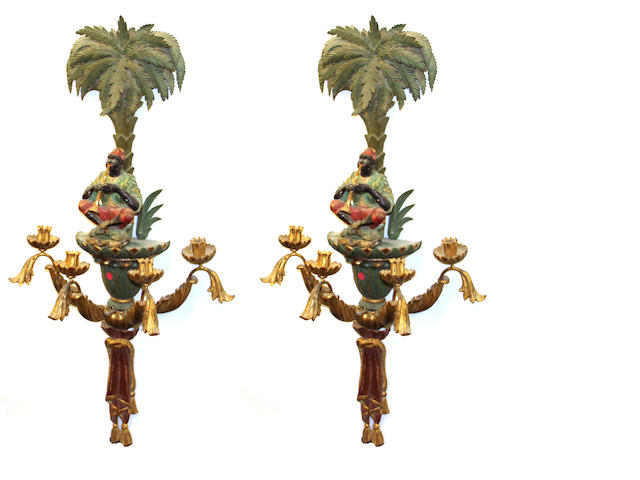 A pair of Neoclassical style polychrome and giltwood figural four light sconces second half 20th century