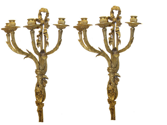 A pair of Louis XVI style cast brass four light bras de lumière second half 20th century