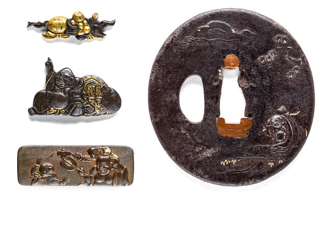 An iron tsuba, a pouch clasp and two menuki Edo period (18th-19th century)