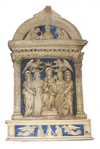 A Della Robbia style glazed terracotta panel of the Virgin and Christ child accompanied by saints and angels late 19th century