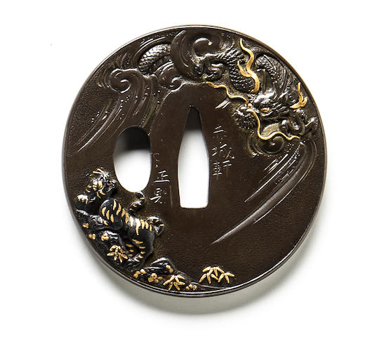 An inlaid iron tsuba By Masanori, d. ca. 1850
