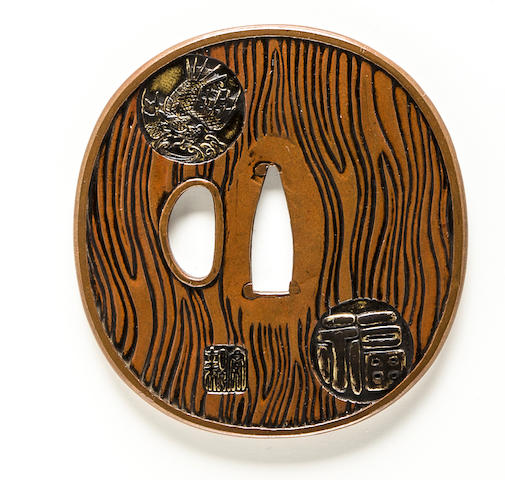 A copper tsuba By Yasuchika, Edo period (19th century)