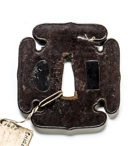 An iron tsuba By Shigenobu, Edo period (17th century)