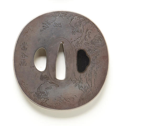 A solid silver tsuba Meiji period (late 19th century)