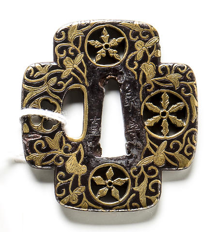 A brass-inlaid tsuba By Koike Yoshiro Izuminokami Naomasa, Edo period (early 17th century)