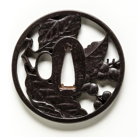 An iron tsuba  By Masakatsu, Edo period (19th century)