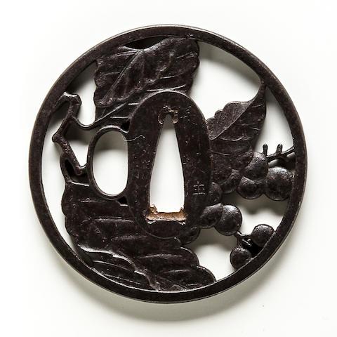 An iron tsuba  By Masakatsu, Edo period (19th century)