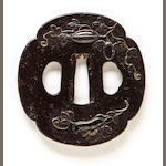 An iron Shoami tsuba By Ikko, Edo period (18th century)