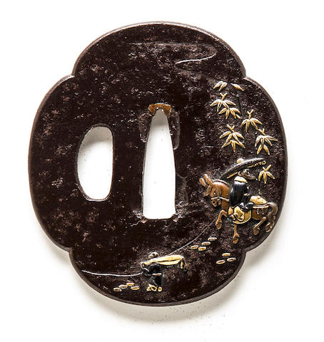 An inlaid iron tsuba Edo period, 19th century