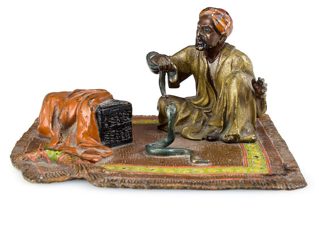 A Franz Bergman cold-painted bronze figure: An Arab Man sitting on a carpet with snakes Vienna, circa 1900