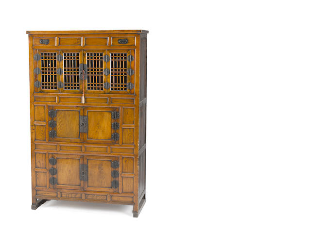 A Korean mixed wood three-tier kitchen cabinet