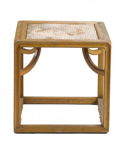 A small mixed wood square side table