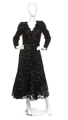 An Oscar De La Renta black lace and sequin long sleeve dress