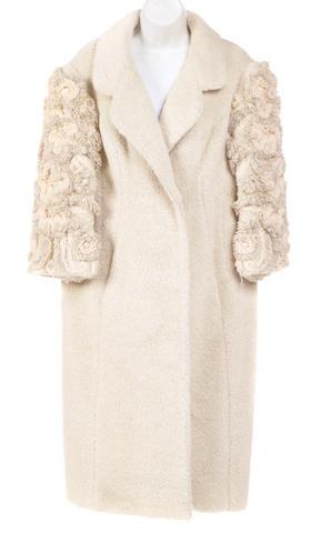 A Galanos cream wool coat