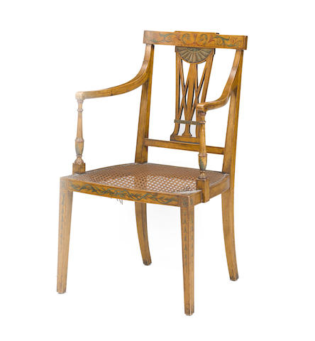 A George III style paint decorated satinwood armchair late 19th century