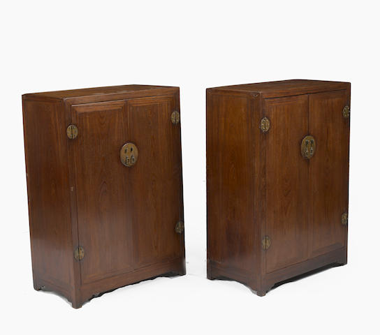 A pair of elm and mixed wood double-door chests