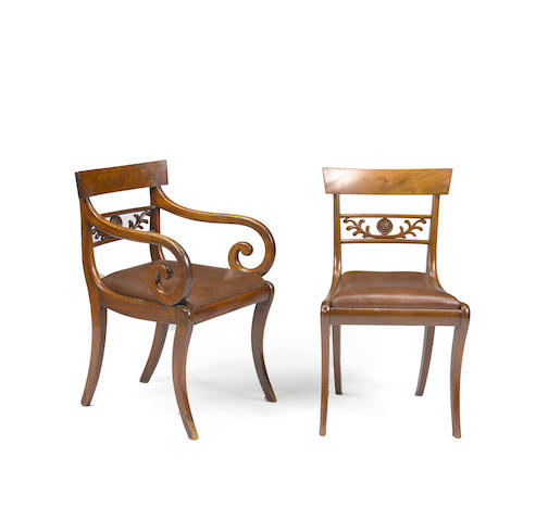 A group of seven Regency mahogany leather upholstered chairs