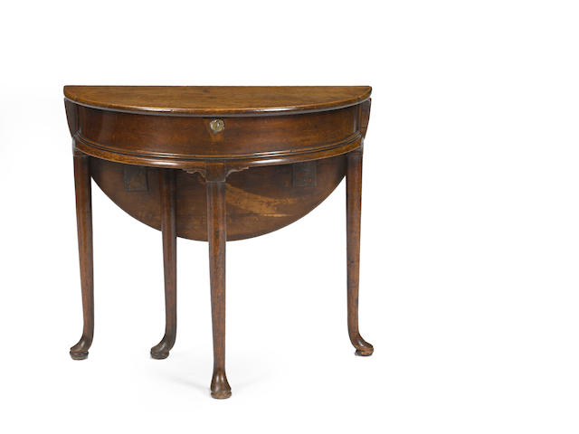 A George II oak demilune foldover card table 18th century