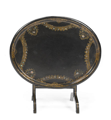 An English Victorian papier mâché oval tray with folding stand