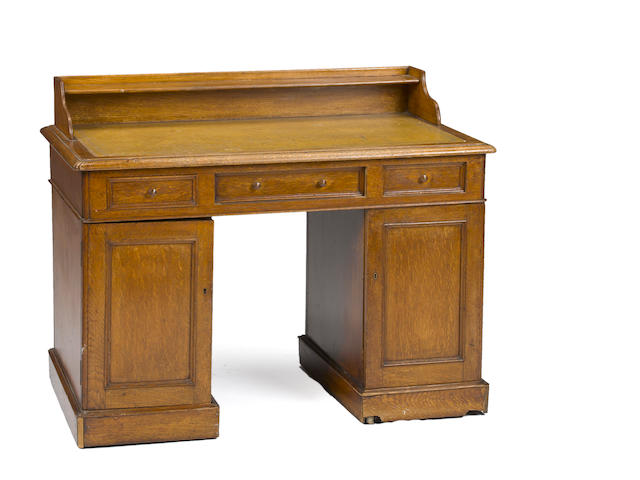 A Victorian oak desk late 19th/early 20th century