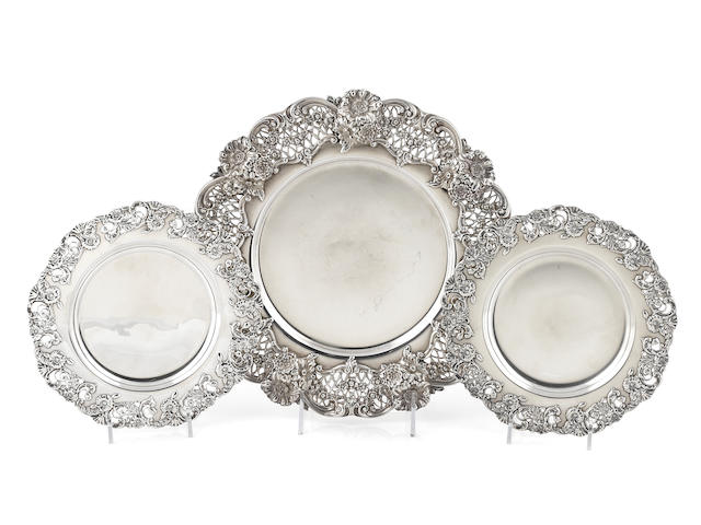 An assembled group of American sterling silver floral-decorated pierced place setting plates late 19th / early 20th century