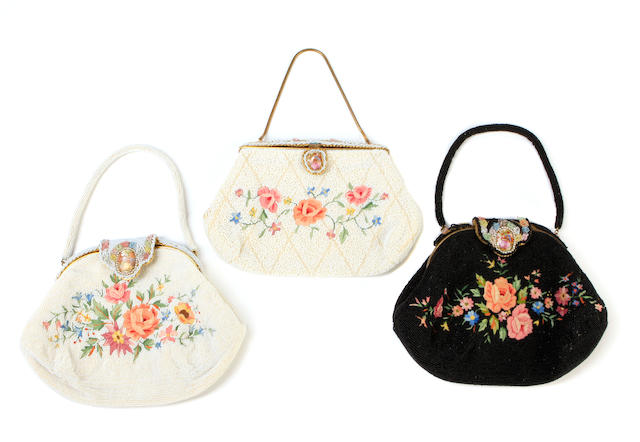 A group of three beaded floral clutches