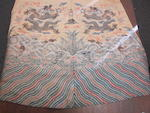 A yellow ground silk brocade dragon robe Late Qing/Republic period