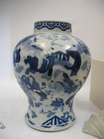 A pair of blue and white porcelain jars with associated lids Kangxi period