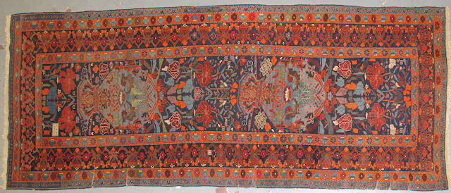 A Karabagh runner size approximately 4ft. 8in. x 11ft. 4in.